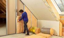 Vkladanie minerálnej izolácie na zlepšenie akustiky konštrukcie